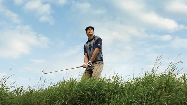 golfer at Fairmont Banff Springs Golf Course, Banff, Alberta