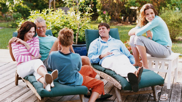 Family sitting on patio talking