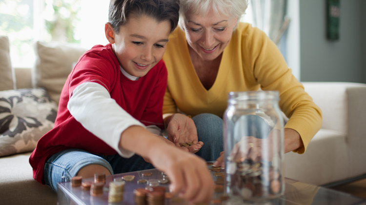 a woman teaching her grandson about money
