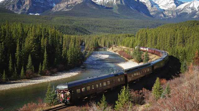 Scenic view of the Royal Canadian Pacific traveling through granite peaks and evergreen forests.