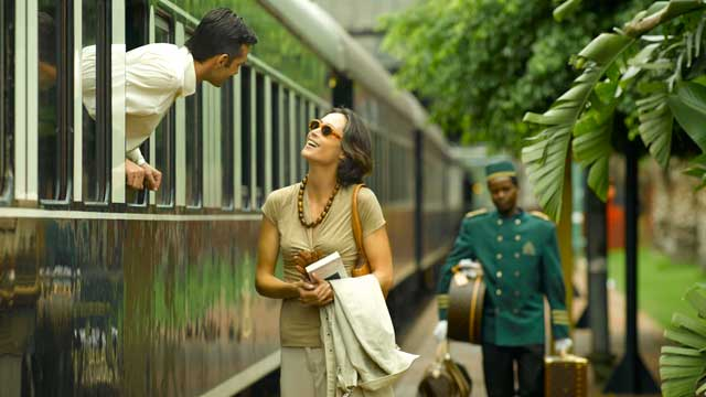A man aboard the Pride of Africa speaks to a woman standing on the platform.