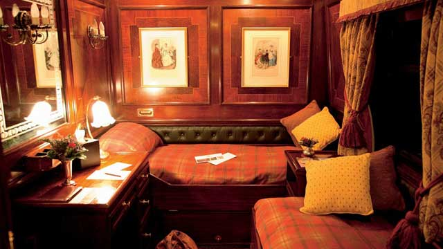 Inside view of a rail car with Edwardian décor.