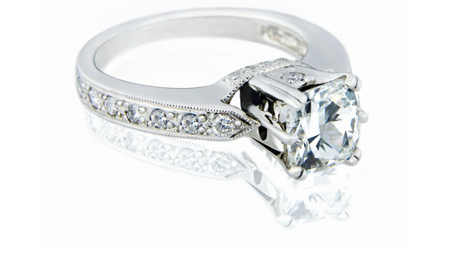 Silver diamond ring with diamond band.