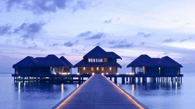 A walkway leading to over water bungalows at Maldives  Luxury Resort