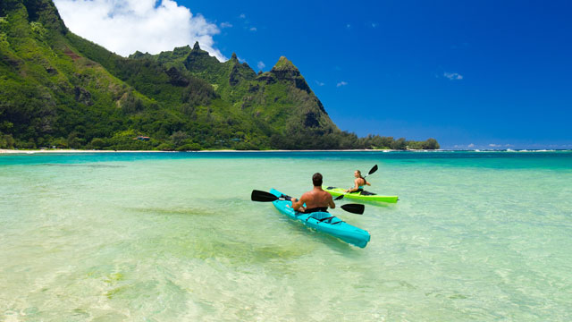 Couple paddling to Mount Makana in Hanalei Bay, Kauai, Hawaii