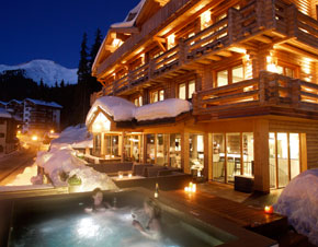 A night view of the exterior of a lodge.