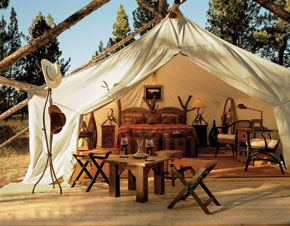 A glamourous camping tent in the Montana wilderness.