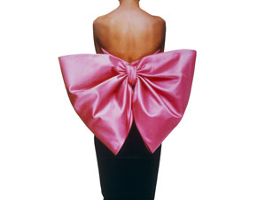 Black velvet sheath dress with a pink satin bow by Yves Saint Laurent