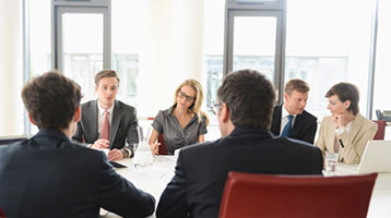 business associates around a negotiation table