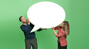 Couple holding a blank conversation bubble