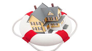 Life insurance: house inside of a life preserver