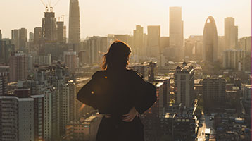 businesswoman overlooking the city