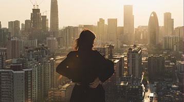 businesswoman overlooking the city