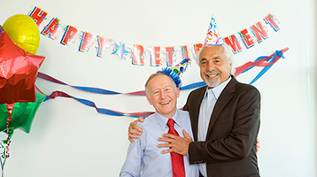 Two men at a retirement party