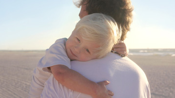 Father holds a son in his arms estate planning