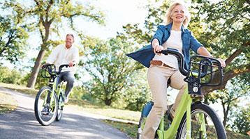 A retired couple rides their bikes