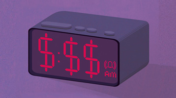 Image of a digital clock with dollar signs