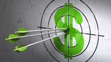 An arrow hitting a target with money symbol on it