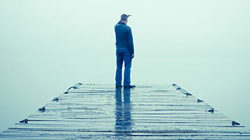 man looking out from a dock