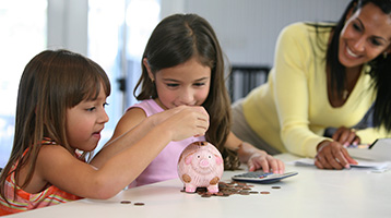 Children with piggy bank